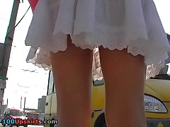 Hot upskirt voyeured at the bus stop