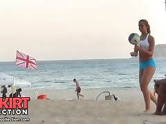 The perfectly shaped amateur gal is playing with the ball in sport shorts on the beach